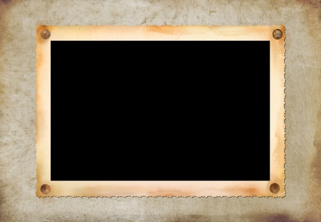 feature films: Vintage photographic blank picture frame om old paper texture
