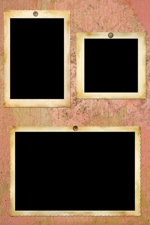 feature films: Vintage photographic blank picture frames on old painted wall