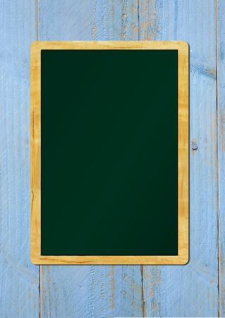 vintage school blackboard on painted wooden wall, free copy space photo
