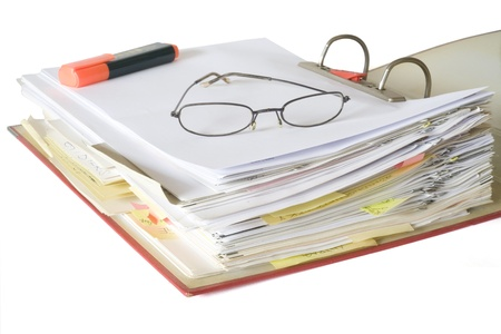 disorganization: open file folder with spectacles and text marker