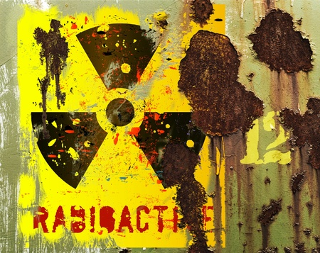poison arrow: grungy radiation sign on a rusty transport container  Stock Photo