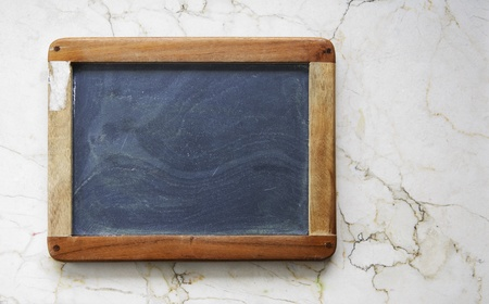 vintage school blackboard on marble wall wall, free copy space Stock Photo