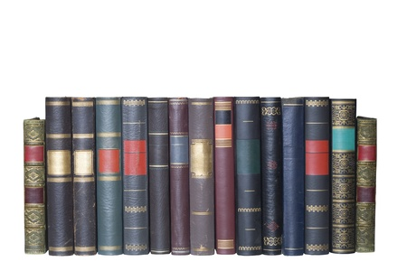 vintage books in a row, isolated on white background, blank labels with free copy space  photo