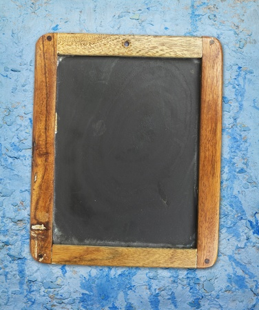 antique sleigh: vintage blackboard on painted grungy wall Stock Photo