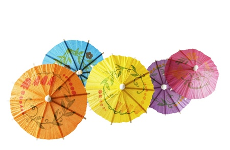 Multicolored Cocktail Umbrellas, spring and summer symbol,isolated on white background Reklamní fotografie