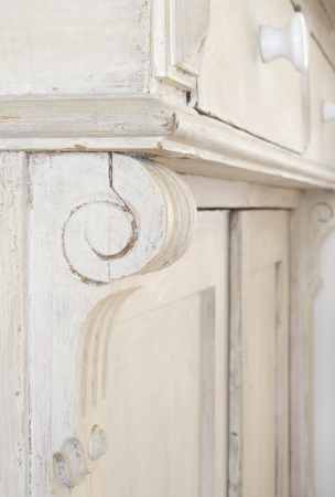 fixtures: Ornament of a vintage cupboard, close up with selective focus