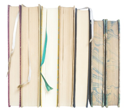 book spine: row of vintage books w. bookmarks, close up, isolated