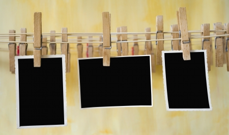Vintage photo frames on a clothesline, free space for your pix