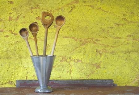 household objects equipment: Old Kitchen utensils, wooden spatulas in a blank sheet beaker