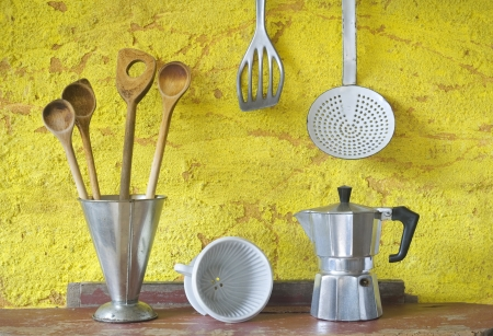 Vintage kitchen utensils, spatualas,espresso maker,skimmer,coffee filter, beaker photo