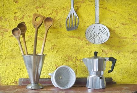 old items: Vintage kitchen utensils, spatualas,espresso maker,skimmer,coffee filter, beaker