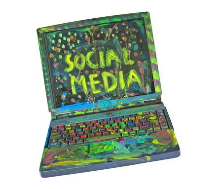 The wonderful world of Social media, grungy painted laptop Stock Photo - 16244622