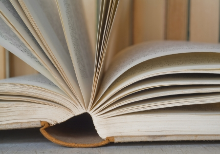 opened book, close up with books in the back, selective focus  Stock Photo - 16352631