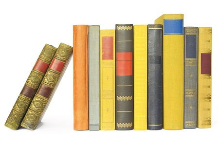 stack of books: vintage books in a row, isolated on white background, blank labels ,free copy space  Stock Photo
