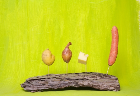 potato, onion, cheese carrot, green background, copy space photo