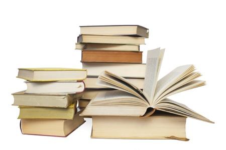stacks of books, one opened, isolated on white background Stock Photo - 17301815