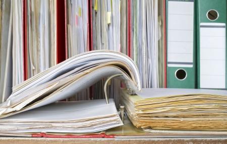 disorganization: open file folder, office folders, close up