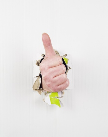 i like thumb, breaking through the background Stock Photo - 17559702