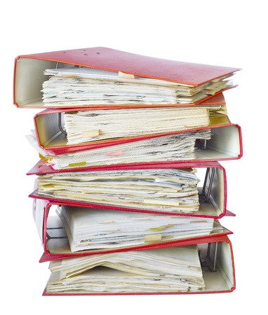 disorganization: stack of file folders, isolated on white background Stock Photo