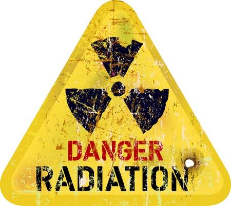 poison arrow: radiation warning, weathered sign, dangerousness of atomic energy