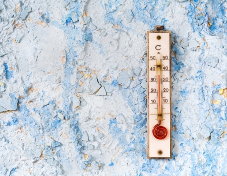 extreme heat: Thermometer on a blue wall, summer,heat, concept