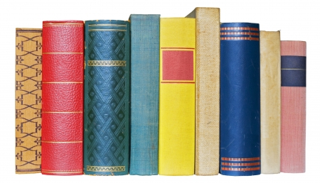 Row of books isolated on white background, free copy space photo