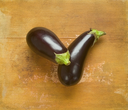 Two eggplants on a wooden board photo