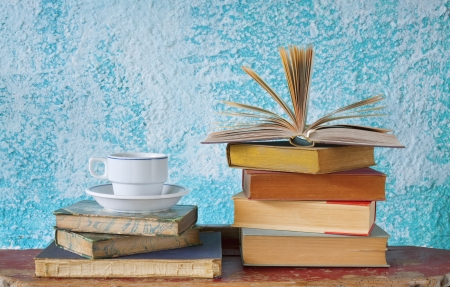 vintage books, with coffee cup, free copy space photo