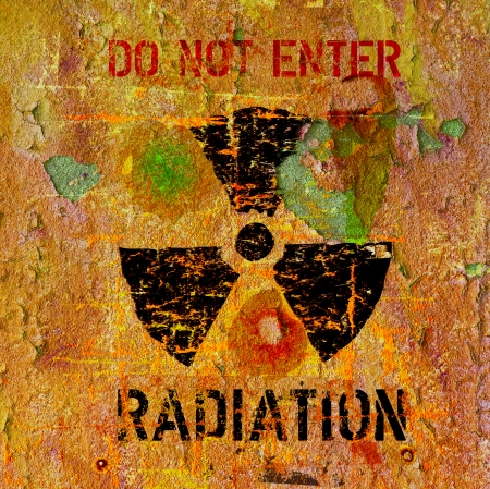 radiation warning sign, on a rusty surface, concept photo