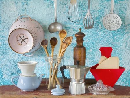 various vintage kitchen utensils,against blue wall Stockfoto