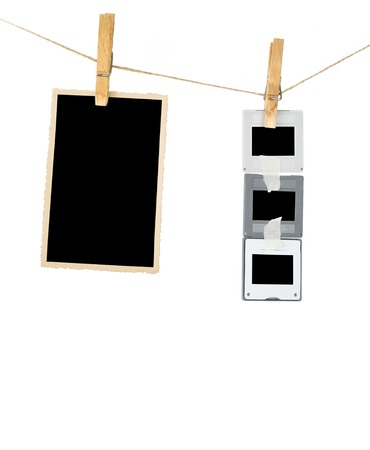 Slides and an aged picture frame hanging on a rope, free space for pix Banco de Imagens - 24959851