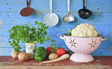 kitchen equipment: various vegetables and vintage kitchen equipment