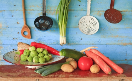 various vegetables and vintage kitchen equipment