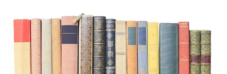 literacy: vintage books in a row, isolated on white background, free copy space