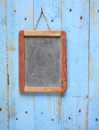 blank old blackboard, on weathered wooden wall,free copy space photo