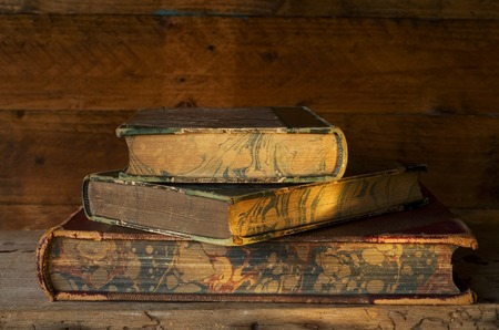 vintage books, close up, evening sun shining in photo