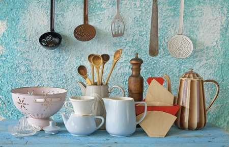 collection of vintage kitchenware, blue wall photo