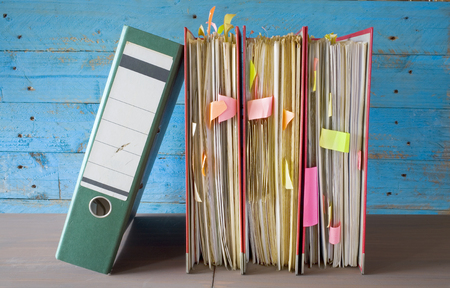 disorganization: row of file folders with messy documents