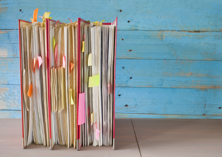 row of file folders with messy documents, free copy space