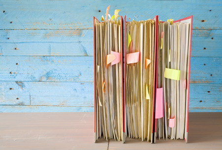 disorganization: row of file folders with messy documents, free copy space