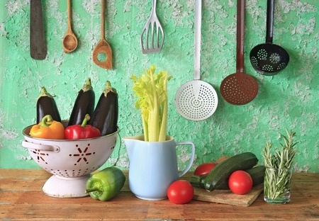various vegetables and vintage kitchen utensils photo