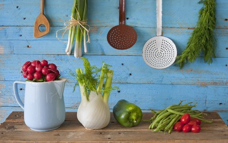 spring onions: vairious vegetables and kitchen retro kitchen utensils Stock Photo