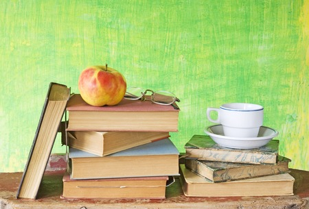 books with spectacles,coffe and apple, free copy space photo