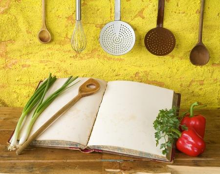 cookbook with free copy space, vintage kitchen utensils, vegetables