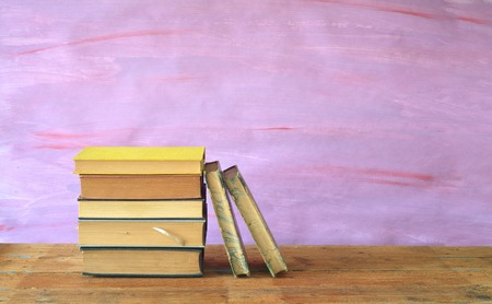 stack of books on purple background, free copy space photo