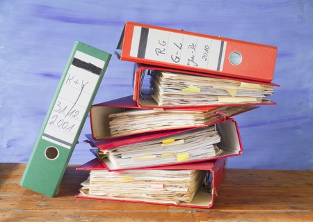 messy file folders, fictional labelling, free copy space Stock Photo
