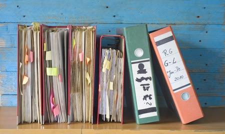 messy file folders, fictional labeling, bureaucracy concept Stock Photo