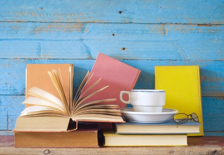 book reading: vintage books with coffee cup and specs, free copy space