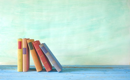 row of books, grungy background, free copy space  Banque d'images