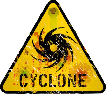 storm damage: cyclone warning sign, heavy weathered